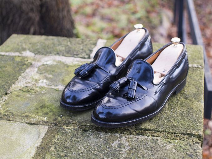 Black shell cordovan tassel loafers by Alden, in the Aberdeen last.​​