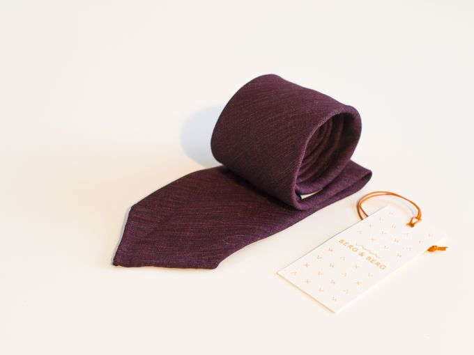 Handrolled burgundy linen tie.