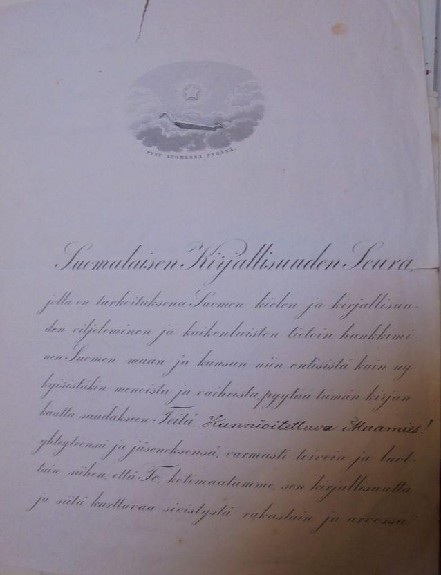 """""""Pysy Suomessa Pyhänä"""". Elias Lönnrothin allekirjoittama """"kutsumuskirje"""" Suomailaisen Kirjallisuuden Seuran jäseneksi vuodelta 1863."""