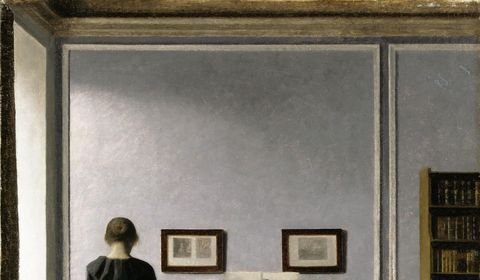 Interior with piano and woman in black press s480x0 c1883x1099 l0x0 q80 noupscale