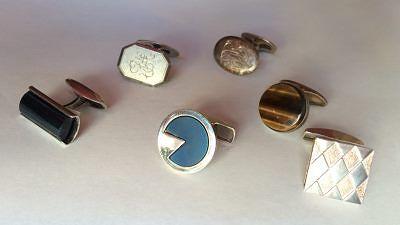 Hopeisia kalvosinnappeja eri materiaalein koristeltuina. Ruutukuvioinen mansettinappi oikealla on Kirsti Doukasin suunnittelema, valmistaja Kaleva Koru, hinta 93 e, muut 48 e / kpl, Momono.