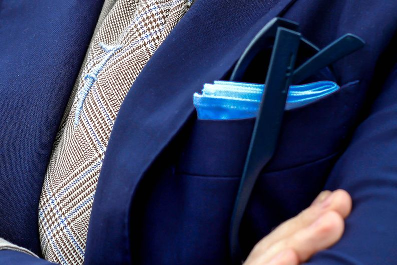 If combined with a pocket square you might want to use a light cotton/linen square.​