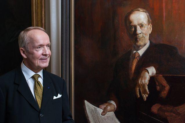 Eero Tarasti beside his portrait.