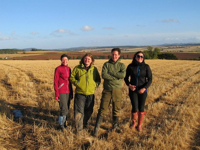 Suzie (far right) with (right to left) Stuart Campbell and Natasha Ferguson of the Scottish Treasure Trove Unit, and Jennifer Novotny of the University of Glasgow, participating in fieldwork at a metal detecting rally in Methven, Perthshire, Scotland, 2013. Photo courtesy of Treasure Trove in Scotland, National Museums Scotland.​​