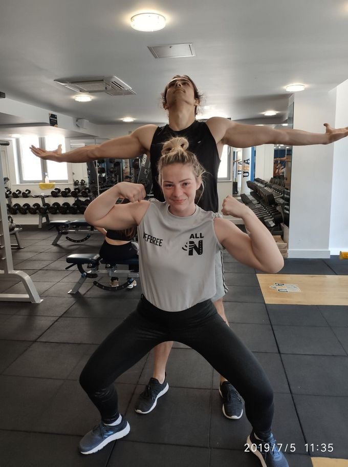 Vlad and Morgan getting their workouts on in the gym.