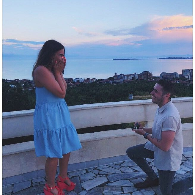 Jake down on one knee, proposing to Dayna in Bulgaria.