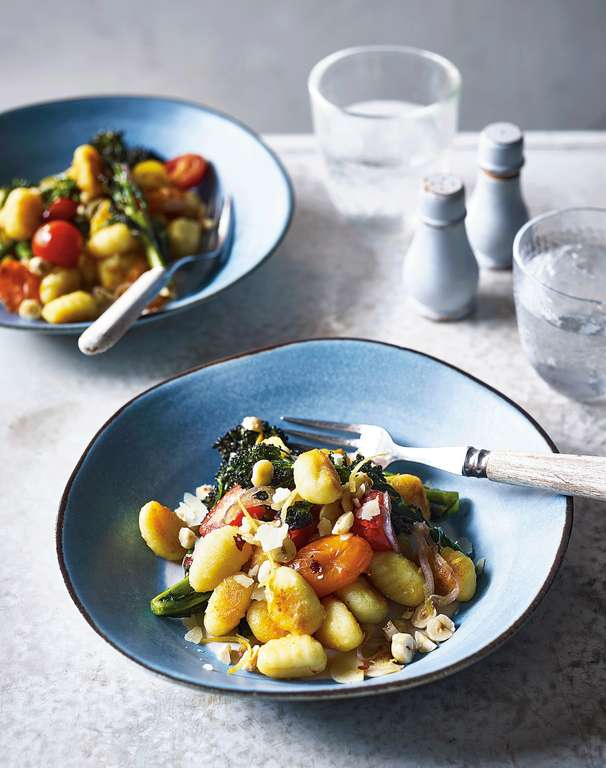 Pan-Fried Gnocchi with Tomatoes, Purple Sprouting Broccoli, and Hazelnuts