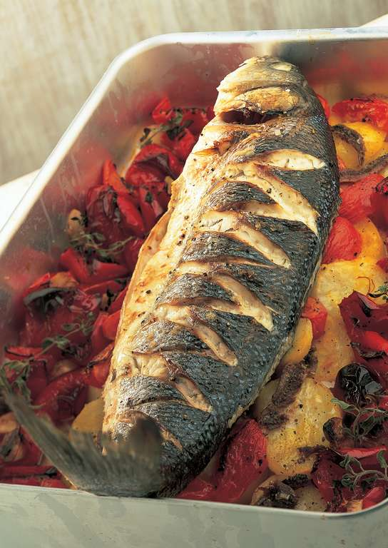 Baked Sea Bass with Roasted Red Peppers, Tomatoes, Anchovies and Potatoes