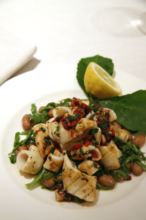 Pan-fried squid with borlotti beans, chilli, anchovy, parsley and chopped rocket