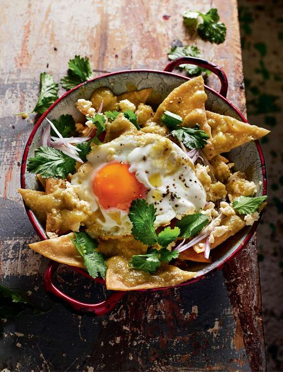 Fried Tortilla Chips in Green Salsa with Crumbled Cheese (Chilaquiles)