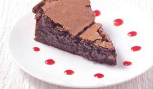Chocolate Cake with Vanilla Whipped Cream and Raspberry Coulis