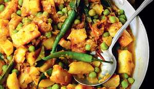 Spicy Fried Potato Curry with Paneer Cheese and Peas