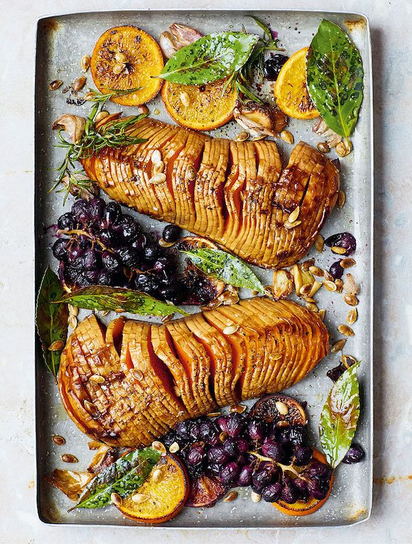 Mouth-watering vegetarian ChristmasHasselback Squash with Roasted Grapesfrom Eat Green by Melissa Hemsley