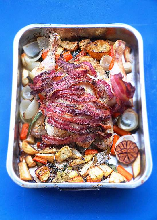 The Christmas Two-Tin Traybake Feast: Roast Chicken with Bacon, Parsnips and Carrots, Roast Potatoes, Pigs in Blankets, Stuffing and Crispy Garlic Sprouts