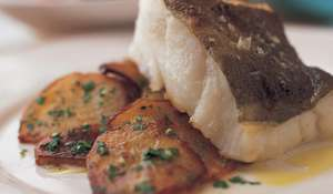 Grilled Cod on Pommes Sarladaise with Truffle Oil