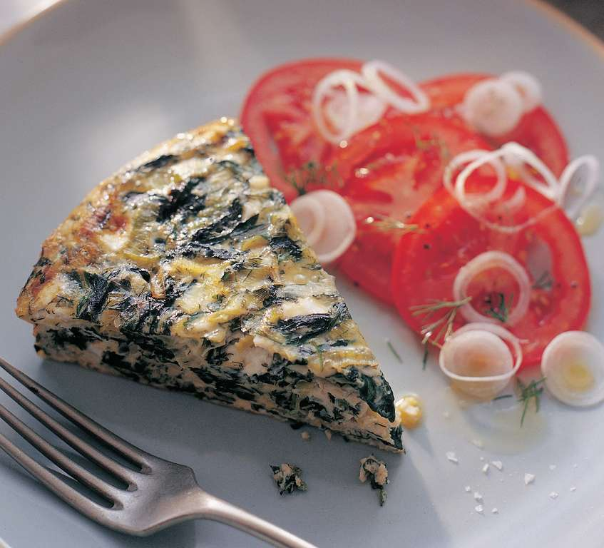 Baked Greek Omelette with Wild Greens, Herbs, Leeks and Feta