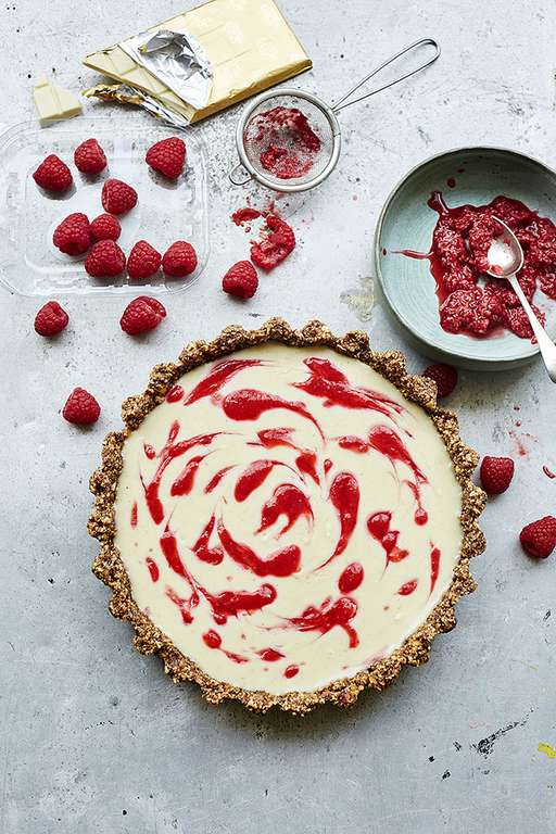 White Chocolate, Cardamom and Raspberry Tart with a Pecan and Hazelnut Base