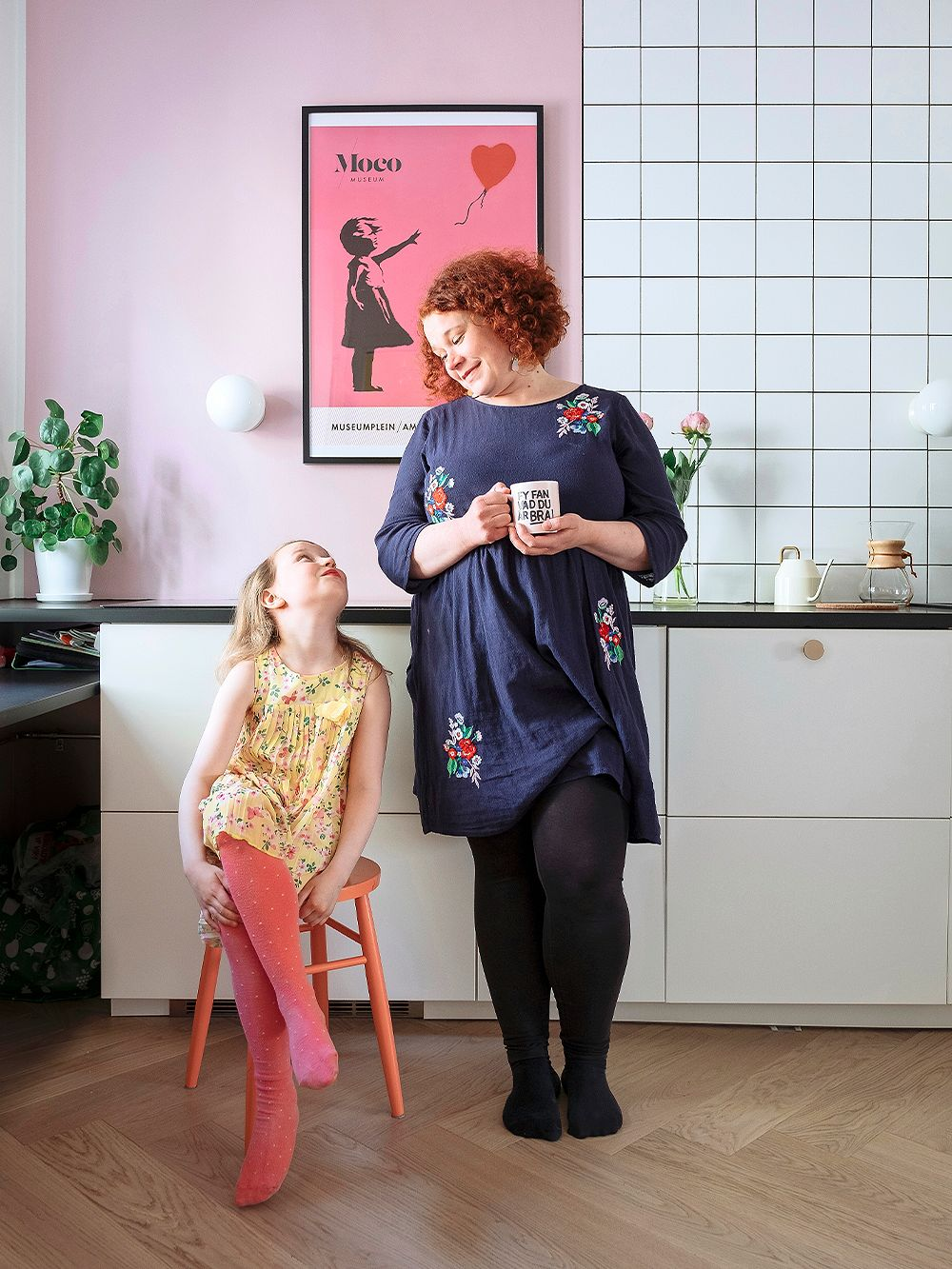 Two-bedroom apartment spiced with pink in Helsinki