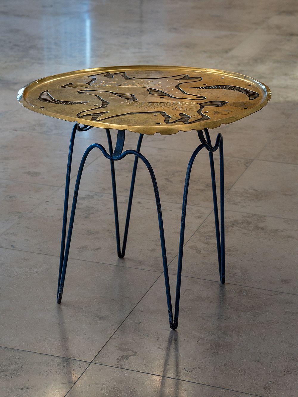 Helena Tynell brass table at Hotel Vaakuna