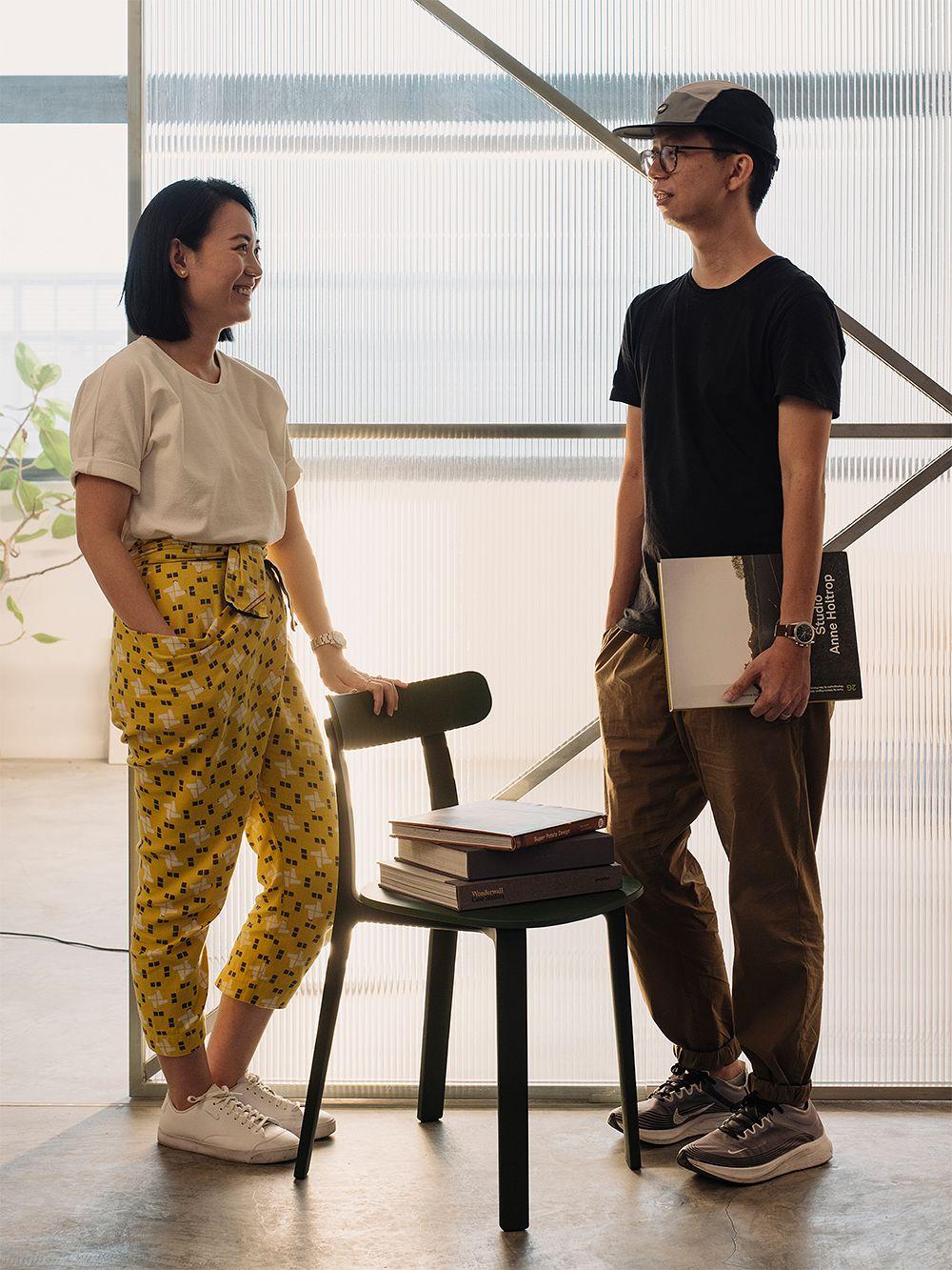 Joy Loo and Khoo Kean Hu with Vitra's All Plastic Chair