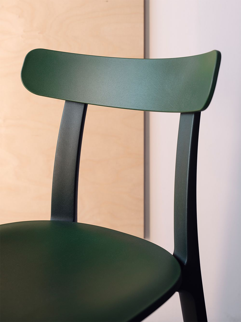 Vitra's All Plastic Chair in ivy green