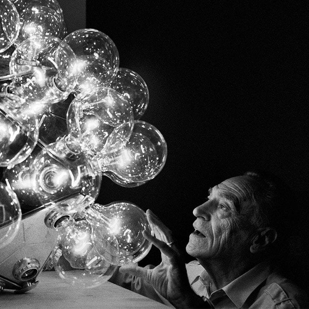 Designer Achille Castiglioni and his Taraxacum 88 lamp.