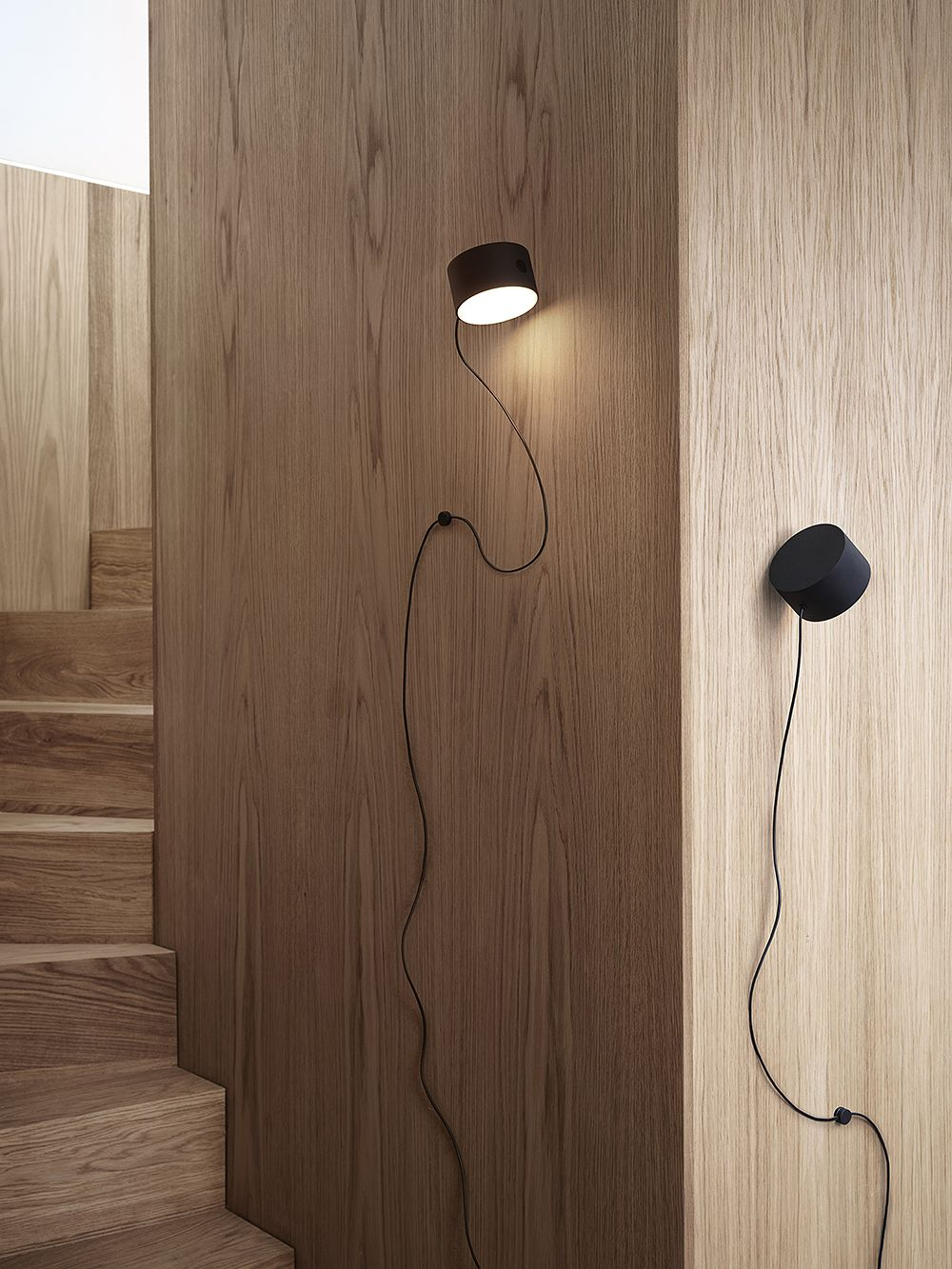 Muuto's Post wall lamp attached to the wall.