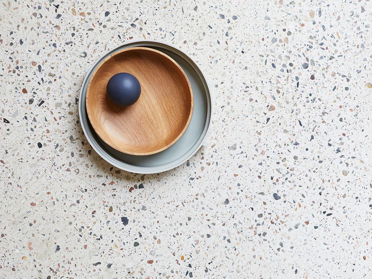 Form & Refine's Section oak bowl on a terrazzo tabletop