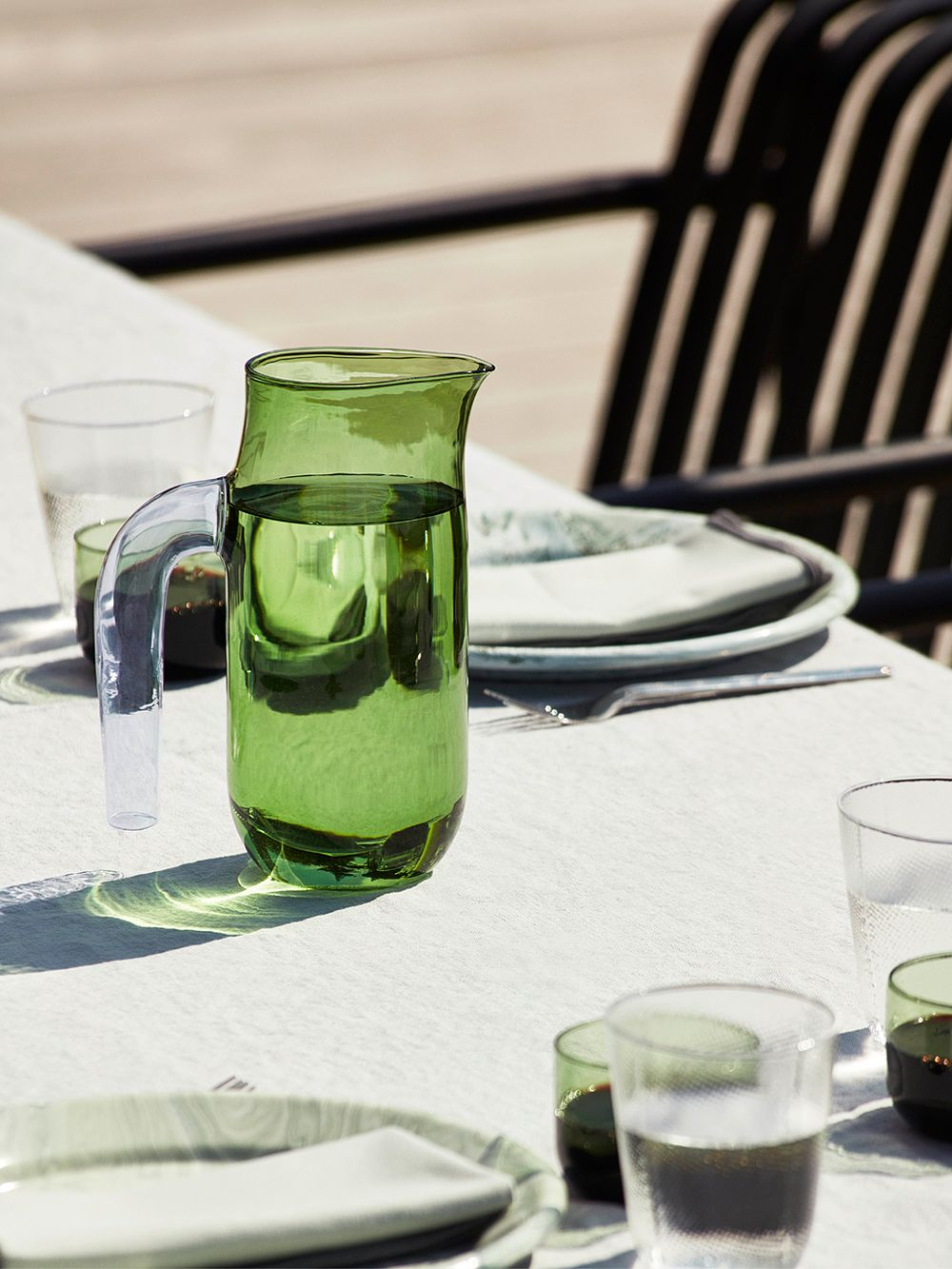 Hay's green glass jug with a lilac handle