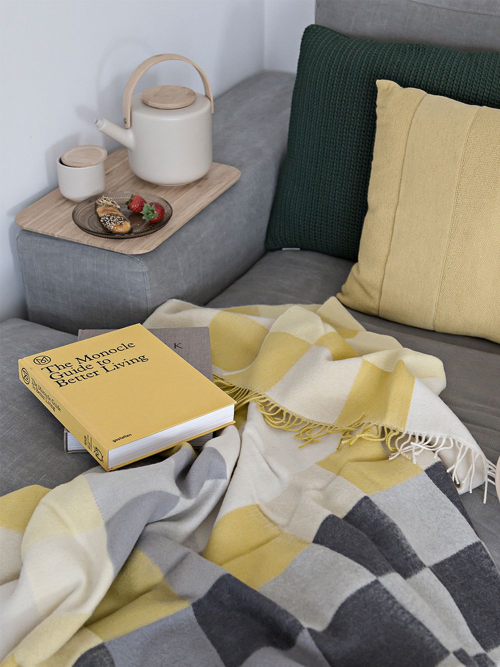Silkeborg Uldspinderie's All Yellow throw on a sofa.