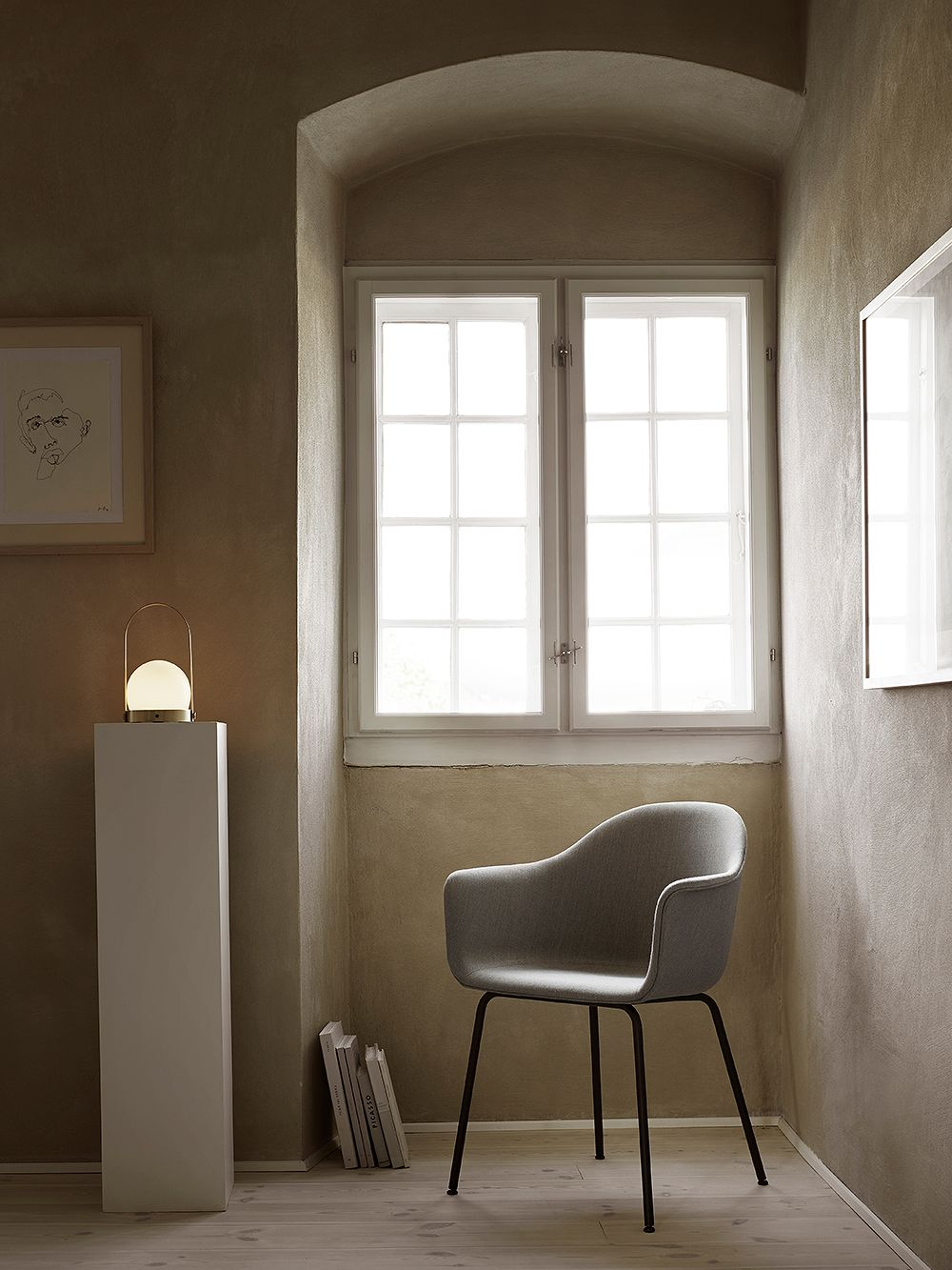 The Carrie lamp by Menu in a reading nook.