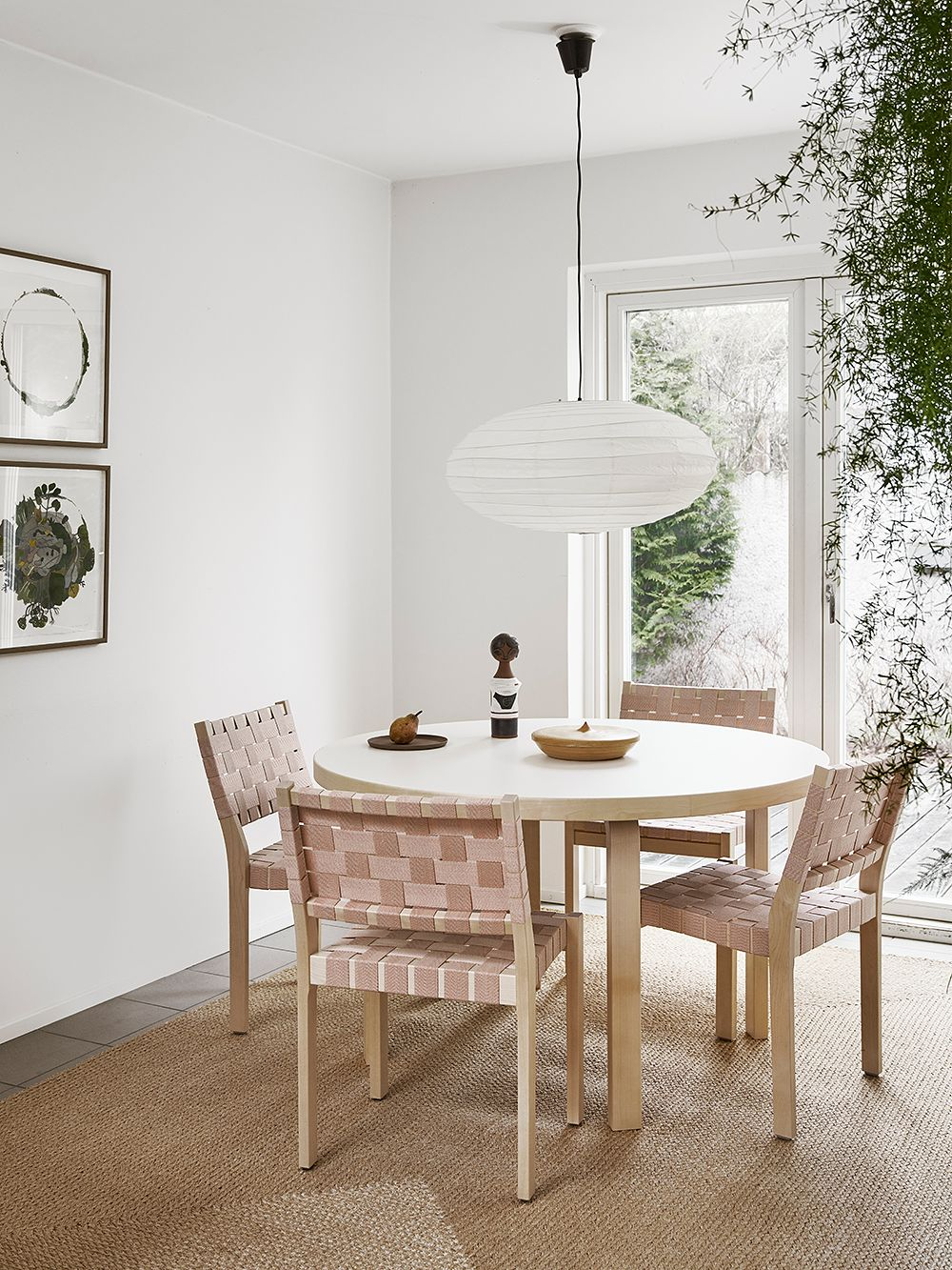 Artek's 611 chairs around a dining table.