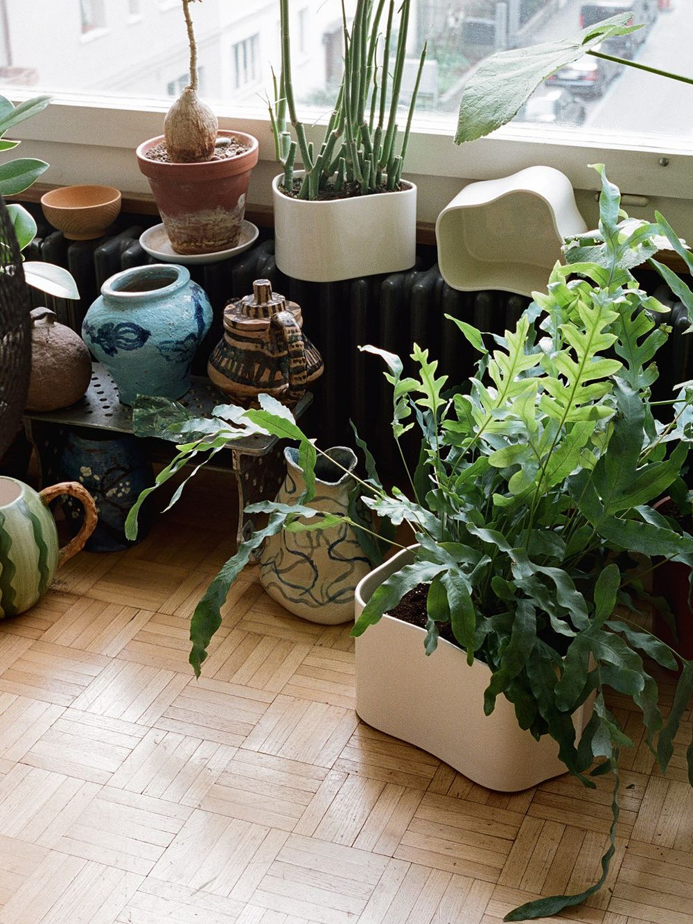 A combination of Artek's Riihitie pots and miscellaneous ceramic items.