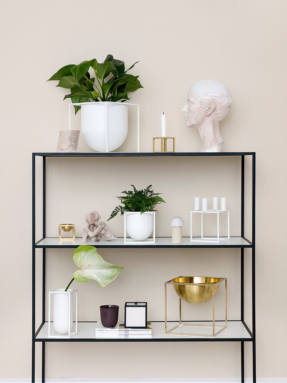 Pieces from By Lassen's Kubus collection displayed on a shelf.