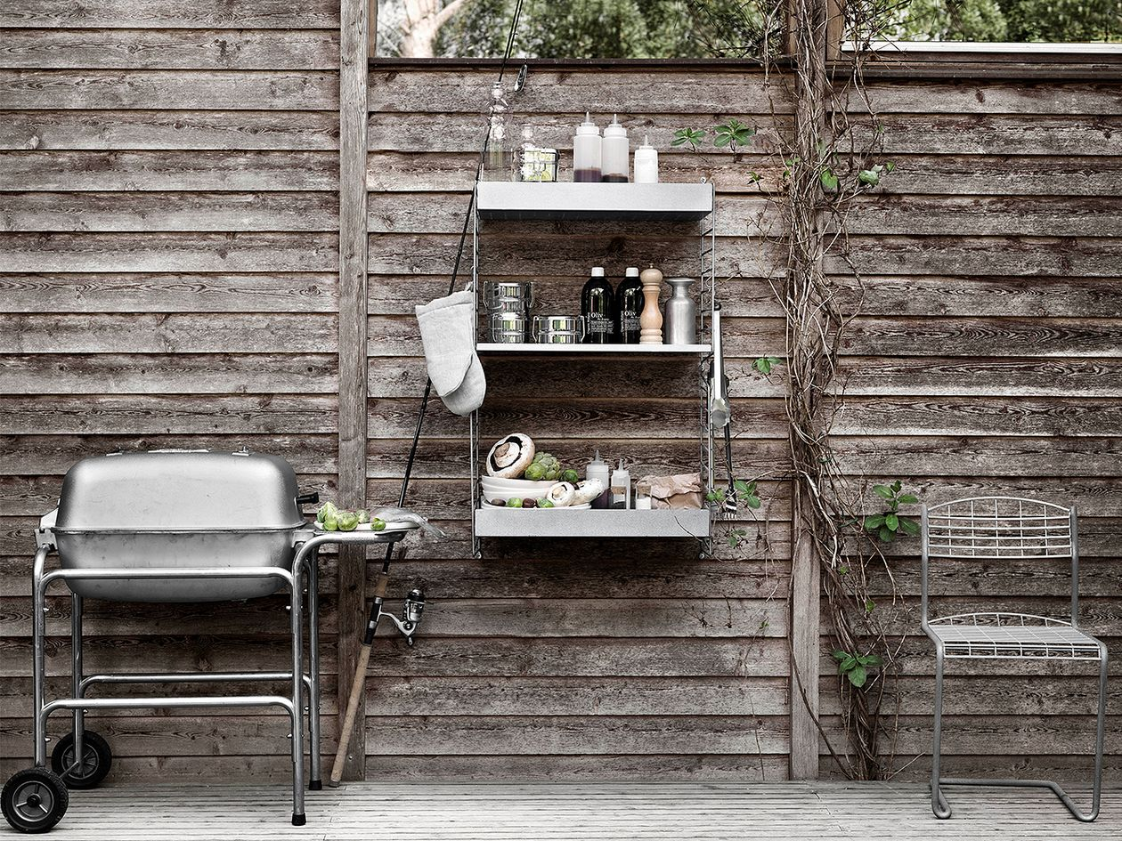 String Furniture's String Outdoor shelving on a patio.