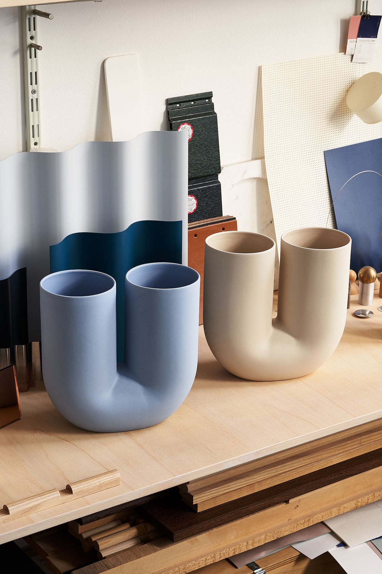 Muuto's Kink vase in light blue and sand.