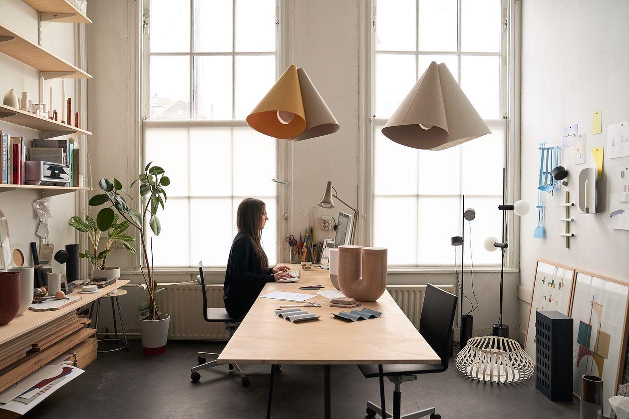Rachel Grifiin at her desk in her workspace.