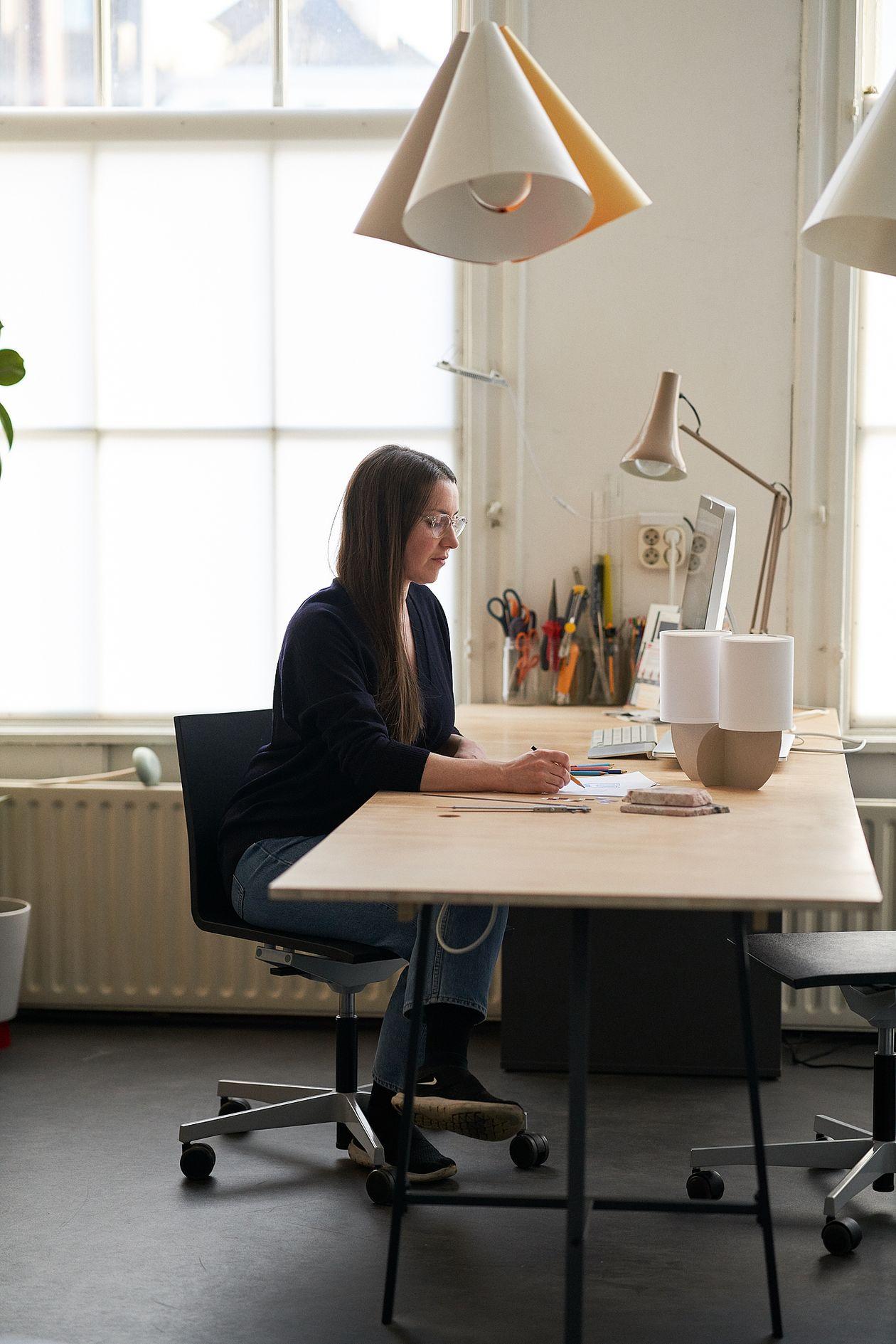 Rachel Griffin at her desk at her studio.