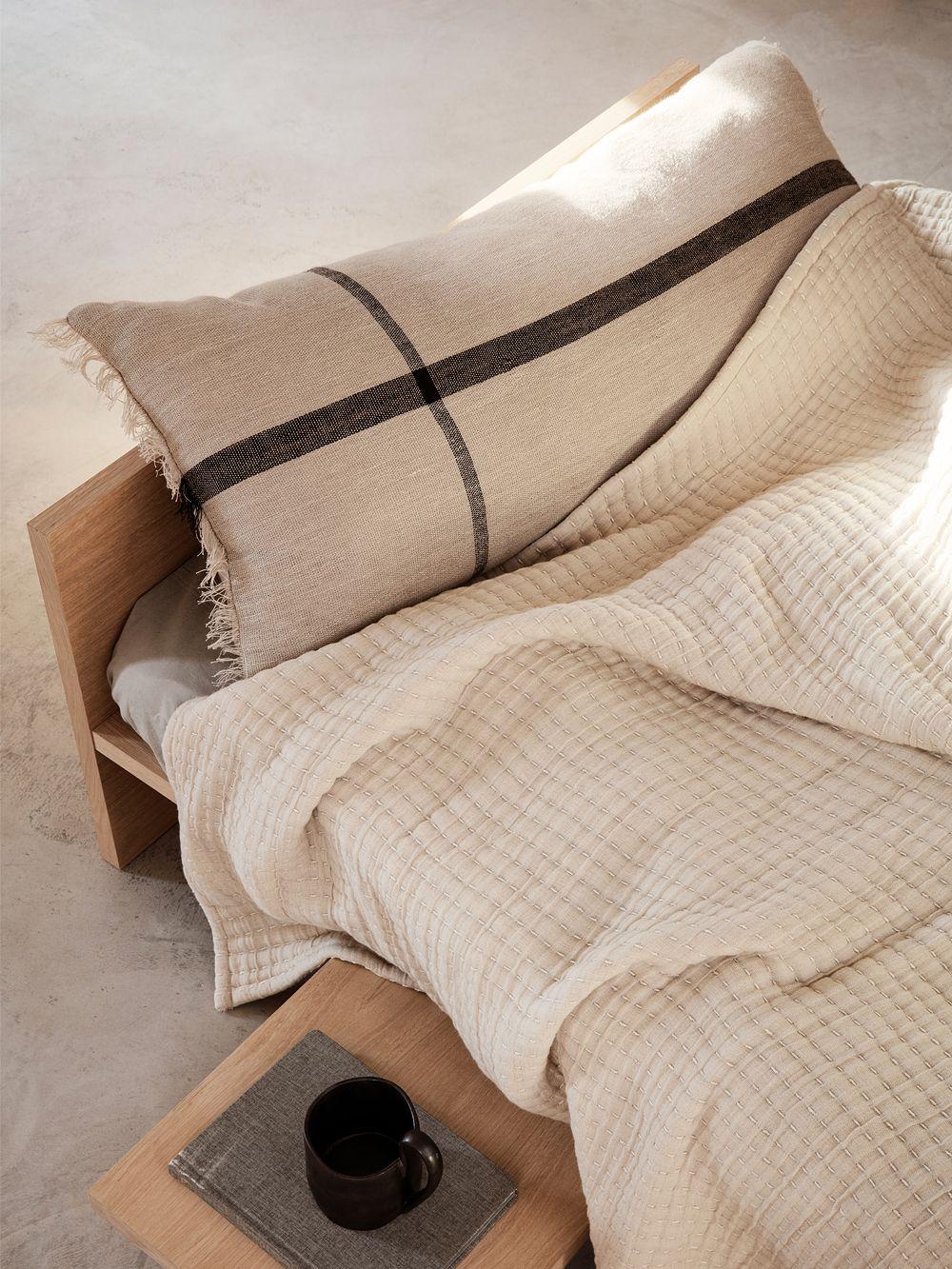 Ferm Living's Calm cushion is bedroom decor.