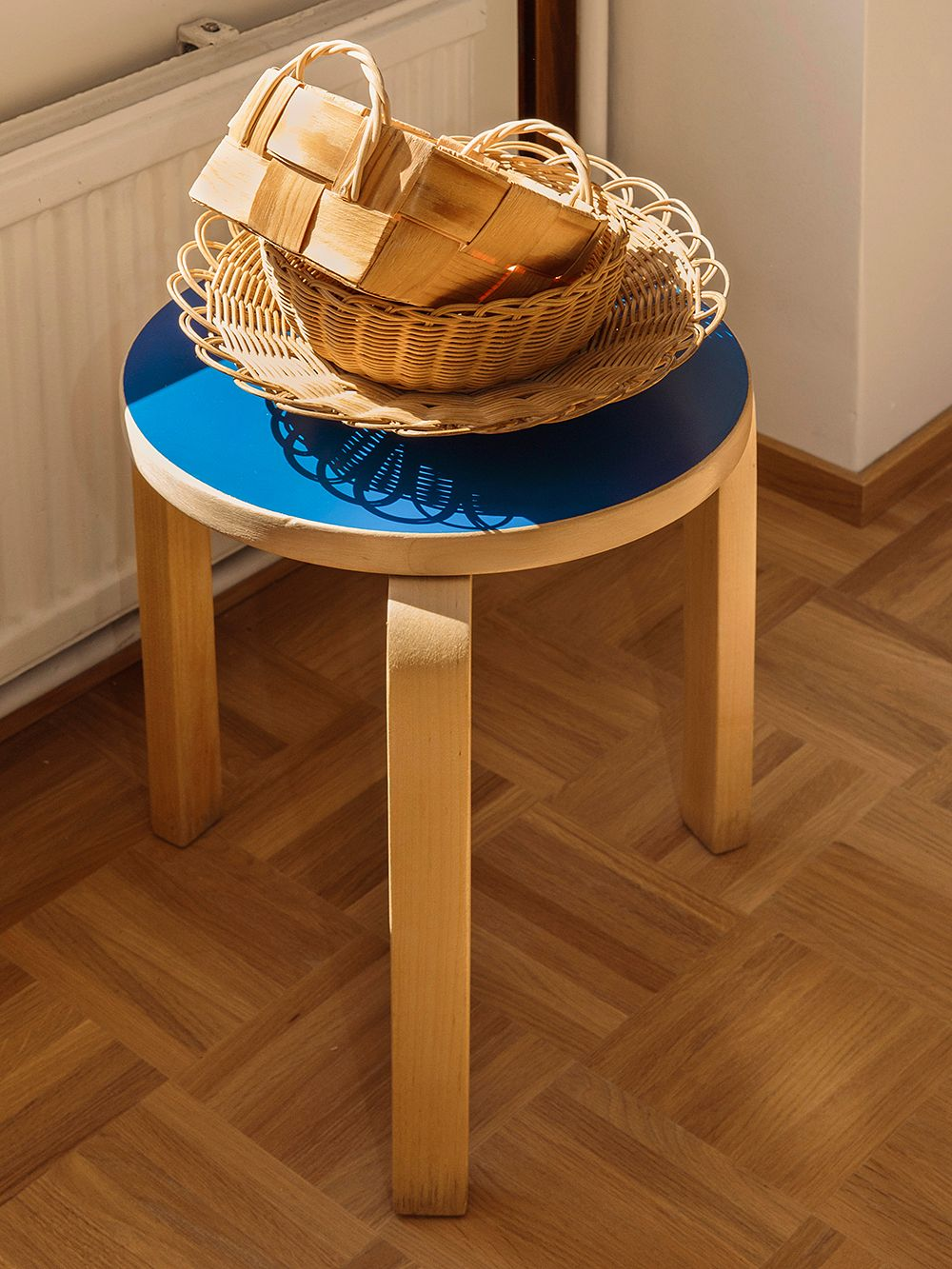 Artek Stool 60 with a blue seating
