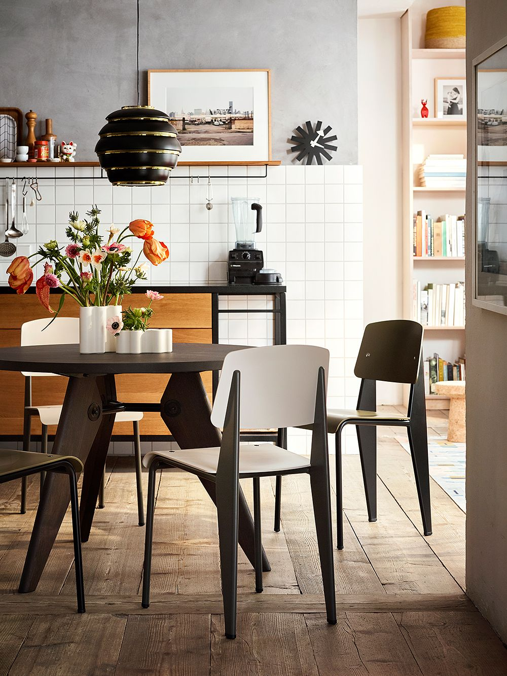 Vitra's Standard chairs, designed by Jean Prouvé, gathered around a dining table