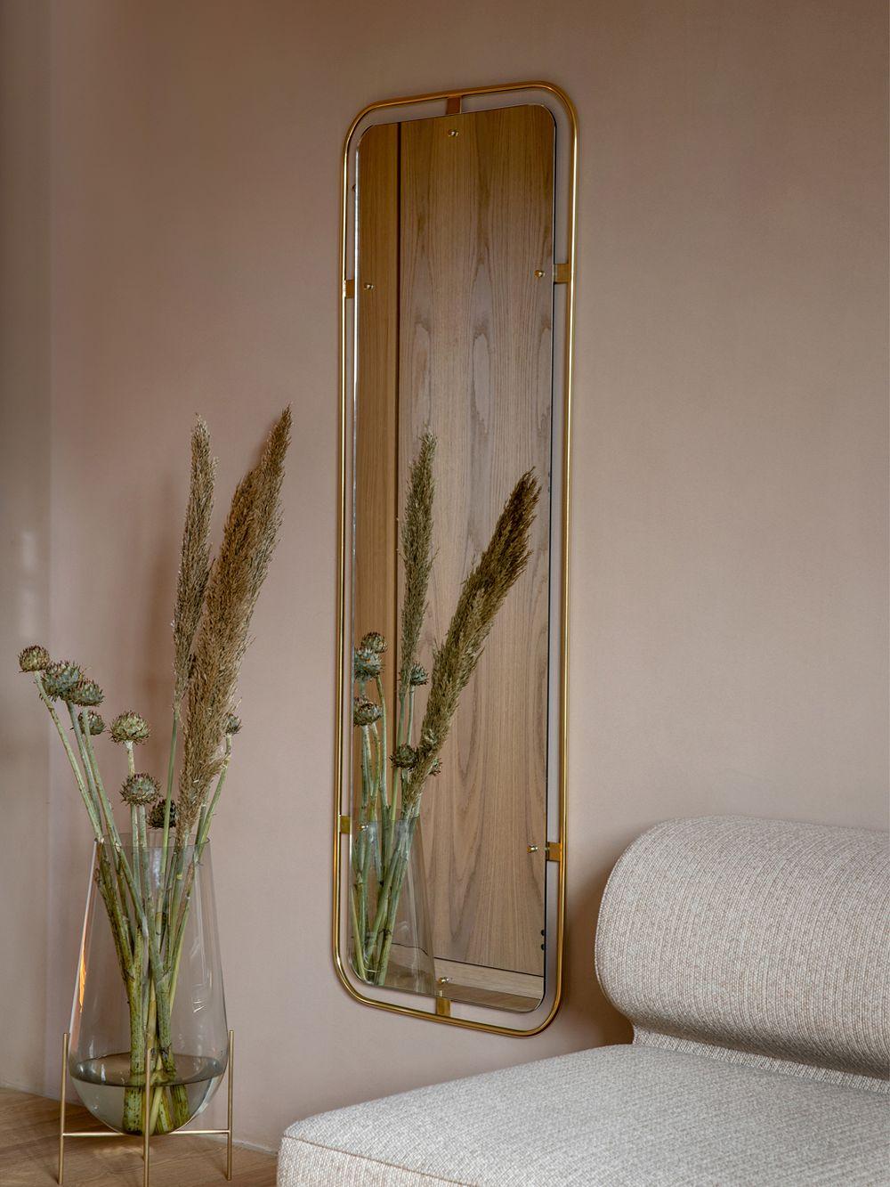 Menu's Nimbus mirror in living room decor.