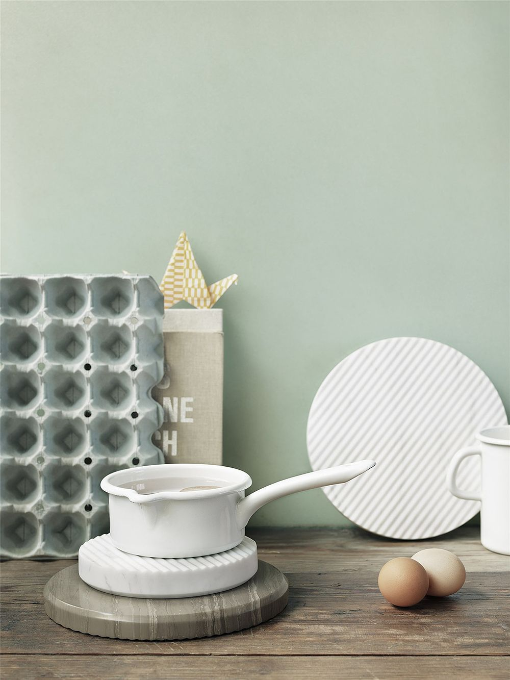 Muuto's Groove trivets in a kitchen setting.