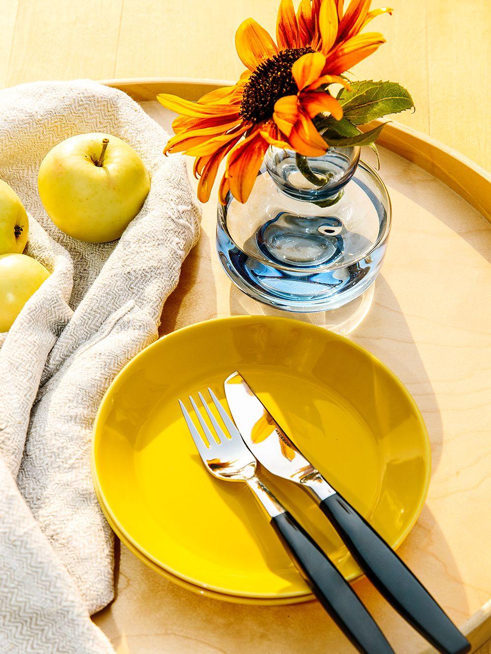 Teema plates in honey by Iittala, blue Flower vase by Marimekko, Lions cutlery by Hackman