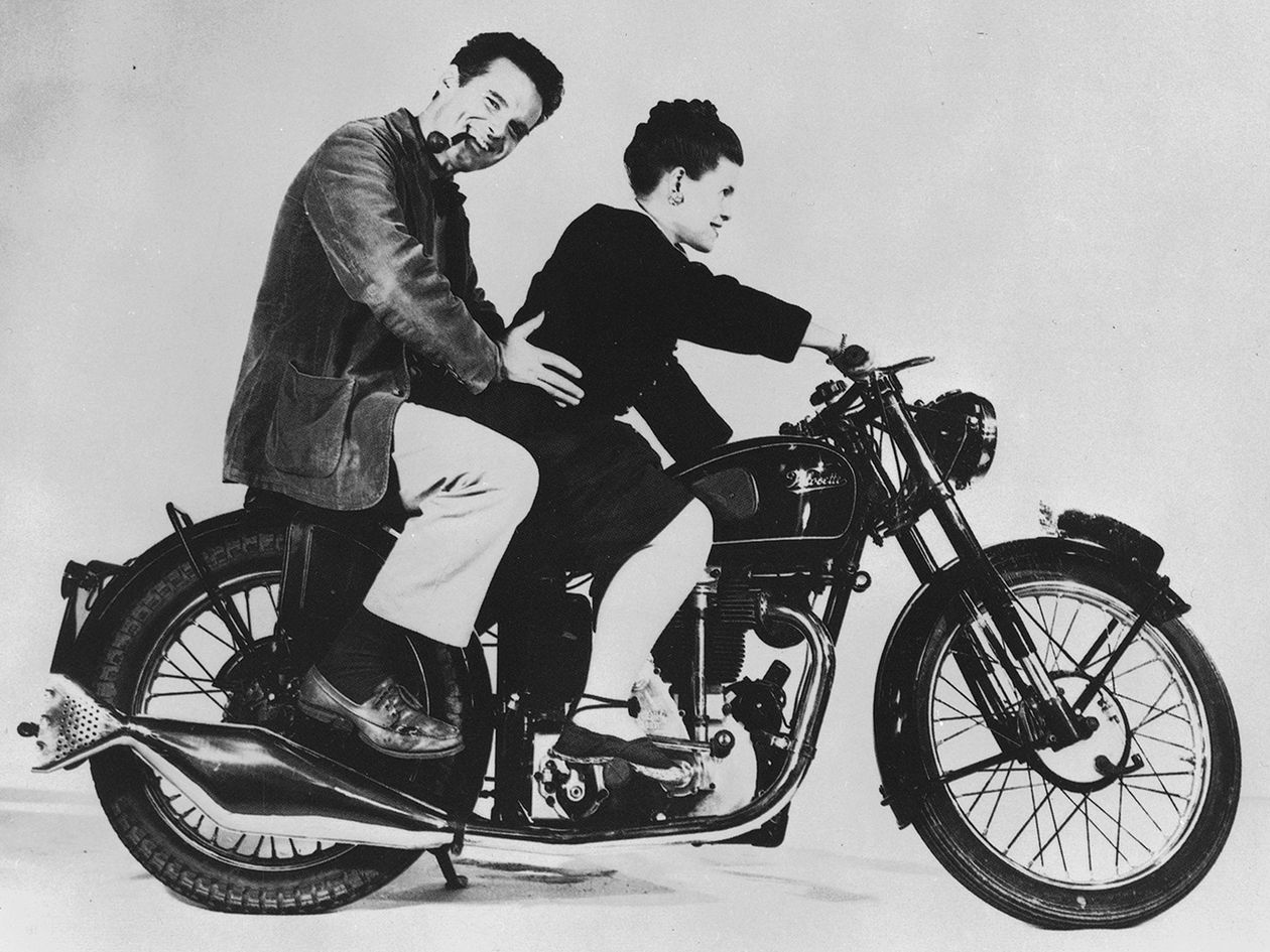Charles and Ray Eames on a motorcycle