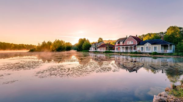 Ferienhäuser im kanadischen Stil am See in Le Lac d'Ailette