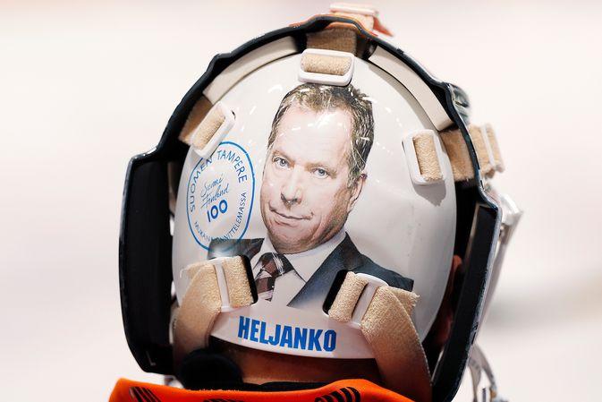 Christian Heljangon Suomi 100 -teemaisessa maskissa esiintyy kolme presidenttiä. Kuva: Jukka Rautio / Europhoto
