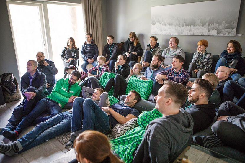 A group of Futurice employees sitting in a semi-circle at the Onboarding Camp.