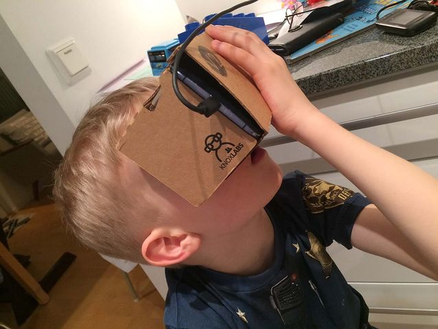 My son learning the planets and moons in our solar system using Google Cardboard and Titans of Space VR app.