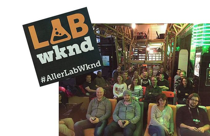 Aller Media Finland's Lab Weekend participators sitting in rows looking at the camera, with the Lab Weekend logo.